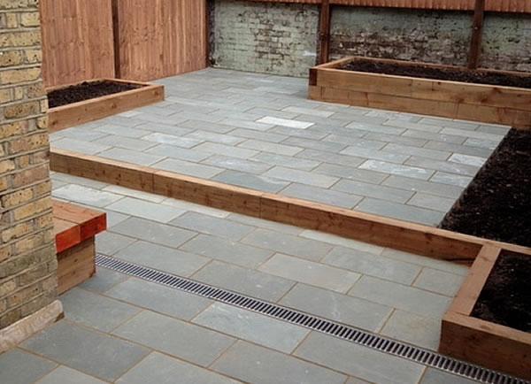 Landscaping garden designs lawns flower beds for Decking in garden design